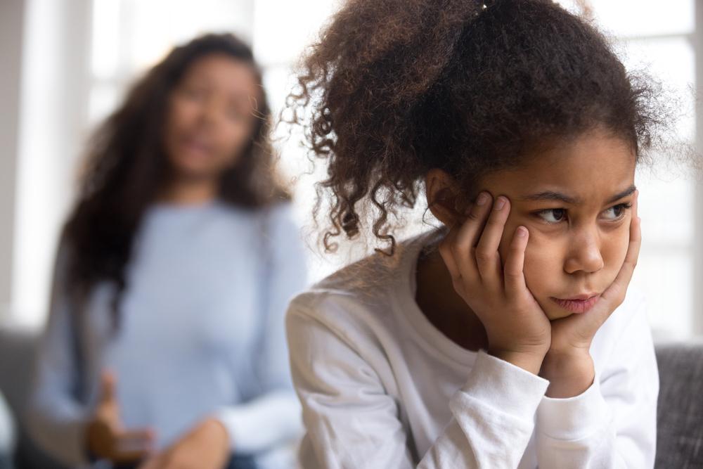 Upset African American preschooler girl looking in distance